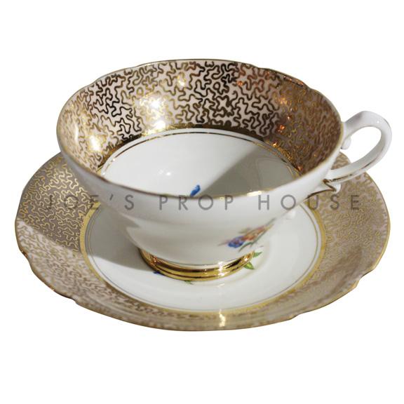 Tasse à thé et soucoupe florale en zigzag