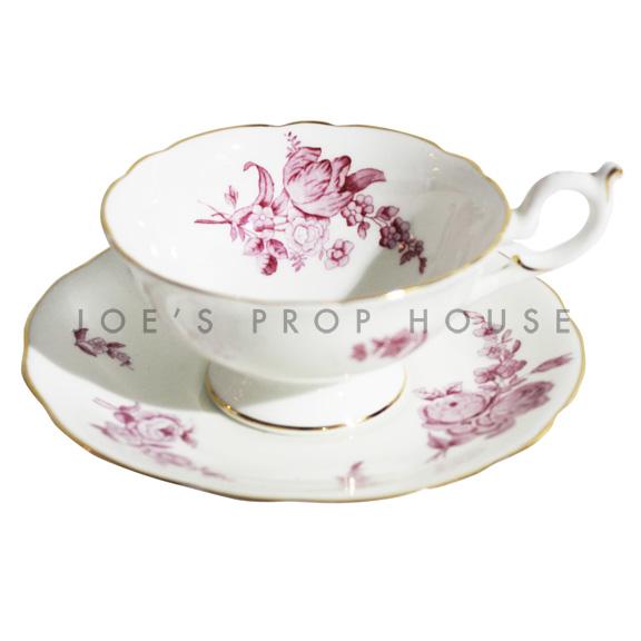 Tasse à thé et soucoupe aux fleurs de houx
